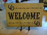<h5>Welcome Etched Stone Sign</h5><p>Welcome sign of etched stone.</p>